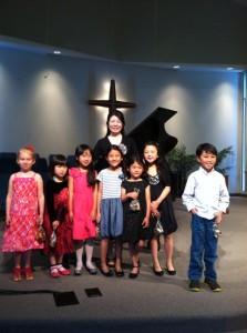 Sarah, Claire, Abigail, Charys, Noelle, Rachel, and Ethan at TVMTA recital