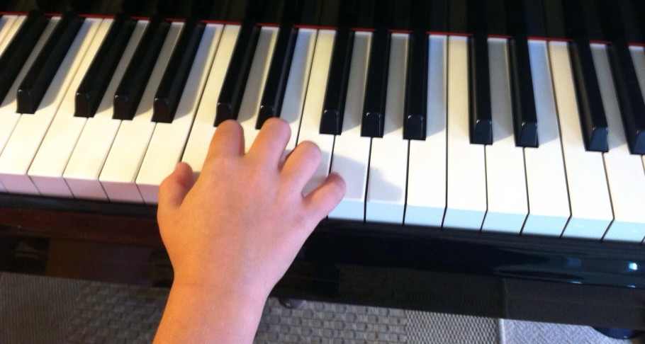 student demonstrating beautiful piano hand